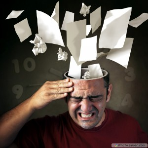 Stress-Concept.-papers-coming-out-of-a-mans-head-with-pain